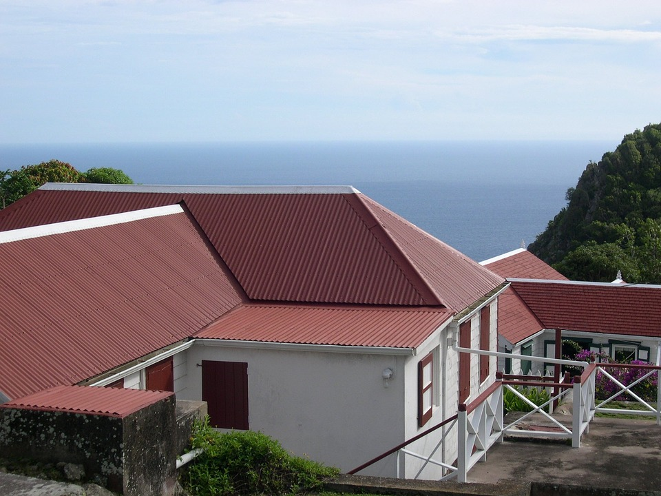 red metal roof installation on sea-side home